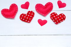 Valentines day background with hearts on the wooden table, top view royalty free stock images