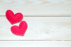 Valentines day background with hearts on the wooden table, top view. Valentines day background with red hearts on the white wooden table, top view, copy space royalty free stock photos