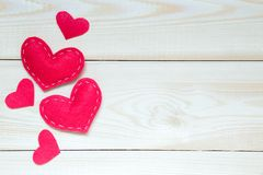 Valentines day background with hearts on the wooden table, top view royalty free stock photography