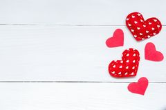 Valentines day background with hearts on the wooden table, top view stock image