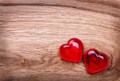 Valentines Day background. Hearts on Wooden Texture Stock Image