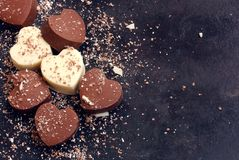 Valentines day background, home made chocolate dark and white hearts royalty free stock photos