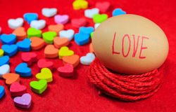 Valentines day background with love text on egg and colorful hea Stock Image