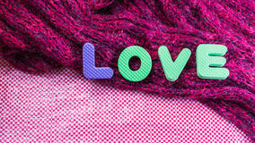 Valentines Day background with  Love text message and scarves. L Stock Image
