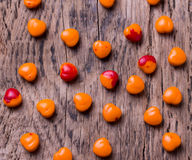 Valentines day background. Orange heart shaped pills or candy. Valentines day background. Orange heart shaped pills or candy on old wooden background Royalty Free Stock Image