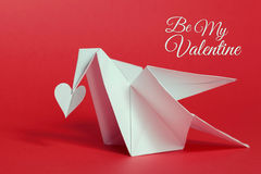 Valentines day background. Origami dove carrying paper heart wit Royalty Free Stock Photos