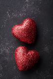 Valentines day background with pair of shiny red heart on black table from above. Stock Photography