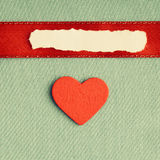 Valentines day background. paper blank heart on green fabric material Stock Photo