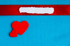 Valentines day background. paper blank hearts on blue fabric material Royalty Free Stock Photo