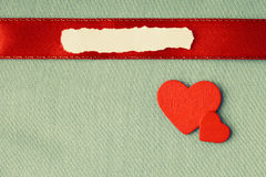 Valentines day background. paper blank hearts on green fabric material Royalty Free Stock Photography