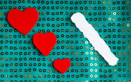 Valentines day background. paper blank hearts on green fabric material Royalty Free Stock Photo