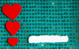 Valentines day background. paper blank hearts on green fabric material Stock Image