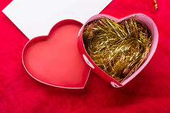 Valentines Day background with paper card on red Stock Images