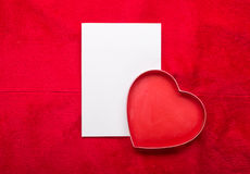 Valentines Day background with paper card on red Stock Photos