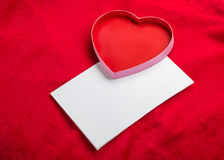 Valentines Day background with paper card on red Stock Image