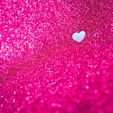Valentines Day background. Pink glitter background with cut out heart shape Royalty Free Stock Photos