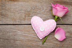 Valentines day background with pink rose and handmaded toy heart Royalty Free Stock Images