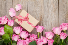 Valentines day background with pink roses over wooden table and Stock Photography