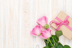 Valentines day background with pink roses over wooden table and Stock Photo