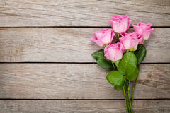 Valentines day background with pink roses over wooden table Royalty Free Stock Image