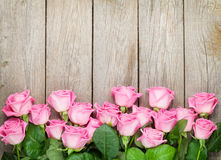 Valentines day background with pink roses over wooden table stock photo
