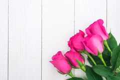 Valentines day background with pink roses on wooden table.  Stock Image