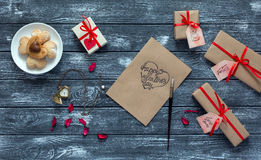 Valentines Day Background Postcard Candies and decorated Gifts on Wood Stock Image