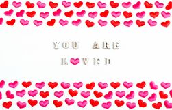 Free Valentines Day Background. Red Hearts And Inscription You Are Loved On The White Wooden Background, St Valentines Day Royalty Free Stock Images - 170006519