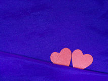 Valentines day background with red hearts on blue fabric. Love and Valentine concept Stock Images