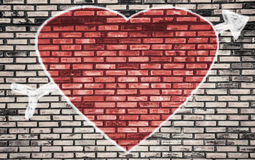 Valentines Day background with red hearts on brick wall Stock Photos