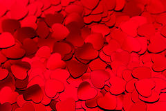 Valentines day background of red hearts confetti. Royalty Free Stock Image
