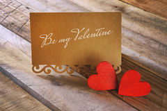 Valentines day background. red hearts next to letter with text: BE MY VALENTINE Stock Images