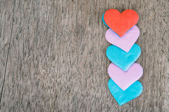 Valentines day background with red hearts over grunge wooden tab Royalty Free Stock Image