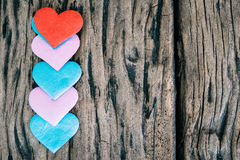Valentines day background with red hearts over grunge wooden tab Royalty Free Stock Photo