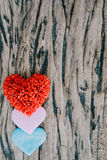Valentines day background with red hearts over grunge wooden tab Stock Photography