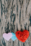 Valentines day background with red hearts over grunge wooden tab Royalty Free Stock Images