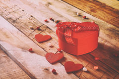 Valentines day background. Red hearts and present box Royalty Free Stock Images