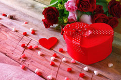 Valentines day background. Red hearts and present box Royalty Free Stock Photos