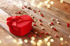 Valentines day background. Red hearts and present box Royalty Free Stock Photo