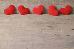 Valentines day background with red hearts on wooden background. Royalty Free Stock Photos