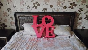 Valentines day background. Red letters love on bed for valentine`s day and christmas. stock video