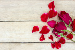 Valentines day background with red roses on wood Stock Photo