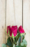 Valentines day background with red roses on wood texture for bac Stock Image