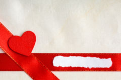 Valentines day background. Red satin ribbon and heart. Stock Images