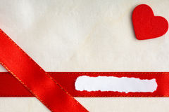 Valentines day background. Red satin ribbon and heart. Royalty Free Stock Images