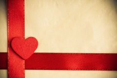 Valentines day background. Red satin ribbon and heart. Royalty Free Stock Photo