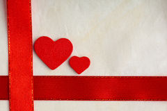 Valentines day background. Red satin ribbon and hearts. Stock Photos