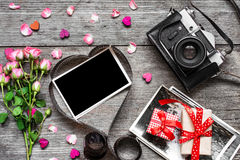 Valentines day background. retro camera and blank photo frame in heart shaped film Stock Photo