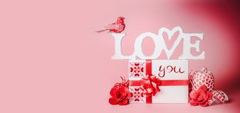 Valentines day background. Romantic composition with Love you message, gift box, red ribbons and hearts. Festive greeting concept. Love declaration concept royalty free stock photos