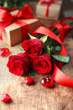 Valentines Day background. Roses with red ribbon and a hearts on wooden board, Valentines Day background, wedding day Royalty Free Stock Images